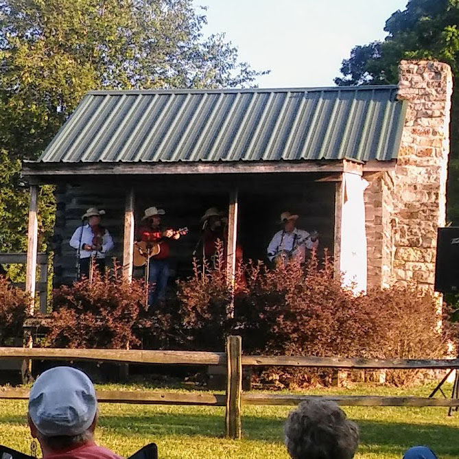 A band plays on the porch of Callway Cabin
